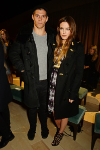 LONDON, ENGLAND - FEBRUARY 22:  Ben Smith-Petersen (L) and Riley Keough wearing Burberry at the Burberry Womenswear February 2016 Show at Kensington Gardens on February 22, 2016 in London, England.  (Photo by David M. Benett/Dave Benett/Getty Images for Burberry) *** Local Caption *** Ben Smith-Petersen; Riley Keough