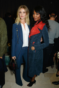 LONDON, ENGLAND - FEBRUARY 22:  Rosie Huntington-Whiteley (L) and Naomi Campbell wearing Burberry at the Burberry Womenswear February 2016 Show at Kensington Gardens on February 22, 2016 in London, England.  (Photo by David M. Benett/Dave Benett/Getty Images for Burberry) *** Local Caption *** Rosie Huntington-Whiteley; Naomi Campbell